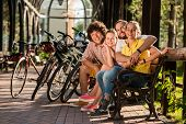 Happy Friends With Bicycles In Park. Cute Cheerful Group Of Friends Enjoying Summer Day In Park. Hap poster