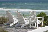 picture of beach-house  - horizontal photograph of wooden deck chairs at the beach - JPG