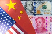Us Dollar And Yuan Banknote On Usa And China Flags. Its Is Symbol For Tariff Trade War Crisis Betwee poster