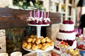 Stylish Candy Bar With Cakes, Candies, Sweet Cookies, Cake Pops. Delicious Assortment For Wedding Ba poster