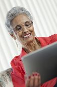 Senior Woman With Digital Tablet