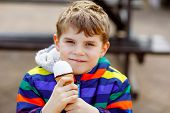 Little Blond School Kid Boy With Curly Hairs Eating Ice Cream Cone, With Waffle Outdoors On Warm Sun poster