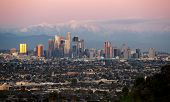 Panoramic View Of The City Of Los Angeles California With Snowy Mountain Caps Showing The End Of The poster
