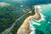 Aerial View Of Vehicles Driving On Great Ocean Road Along Scenic Coastline Near Lorne, Australia poster