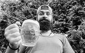 Man Relaxing Enjoying Beer In Summer. Hipster Brutal Bearded Man Hold Mug Cold Fresh Beer. Alcohol D poster