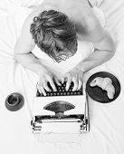 Man With Typewriter And Coffee Lay Bed. Author Guy Tousled Hair Busy Write Chapter Deadline Coming T poster