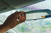 Adjusting The Rearview Mirror In The Car To Make The Rear View Better On Heavy Rain Days, Rearview M poster