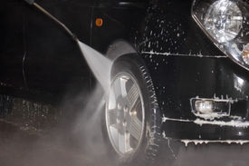 image of car wash  - High pressure carwash system cleaning tyres and disks - JPG