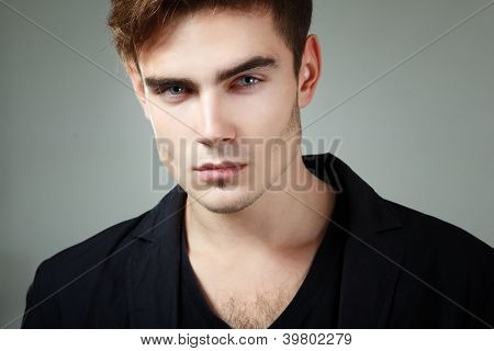 handsome young man face closeup, sexy guy looking at camera, studio