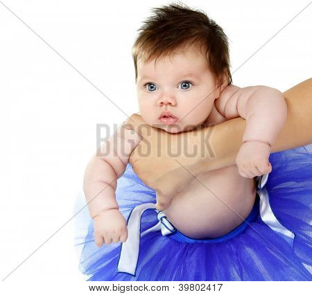 baby girl like a ballet dancer in blue tutu, cute infant over white background