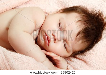 cute infant baby sleeping, beautiful kid's face closeup, studio shot