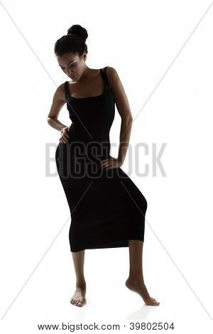 dancing youn woman, silhouette studio shot over white background