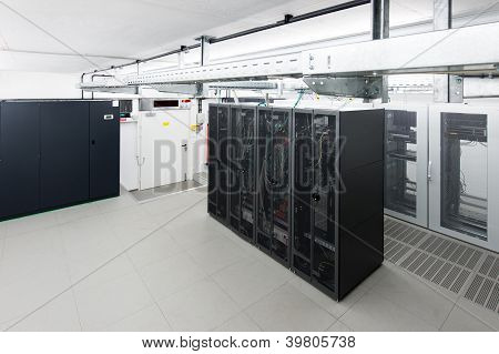 small air conditioned server room with black racks