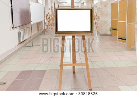 Golden Wood Picture Frame On Easel In Art Gallery Hall