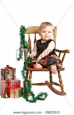 Christmas Baby With Gifts Rocks In Patchwork Dress