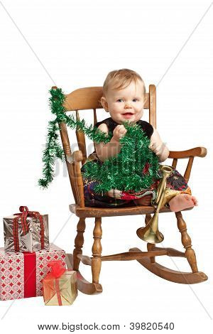 Cute Christmas Baby With Gifts Rocks In Patchwork Dress