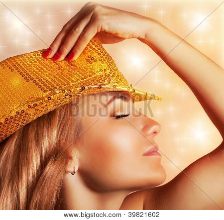 Picture of sexy luxury female wearing fashionable hat with golden glitters, night club, disco dancer, singing girl, evening performance, New Year eve, Christmas party, enjoying music