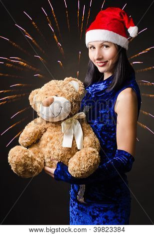 snow maiden presents a toy bear in a gift