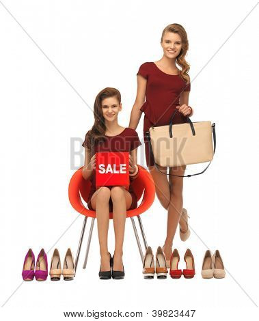 picture of teenage girls in red dresses with shoes, bag and sale sign
