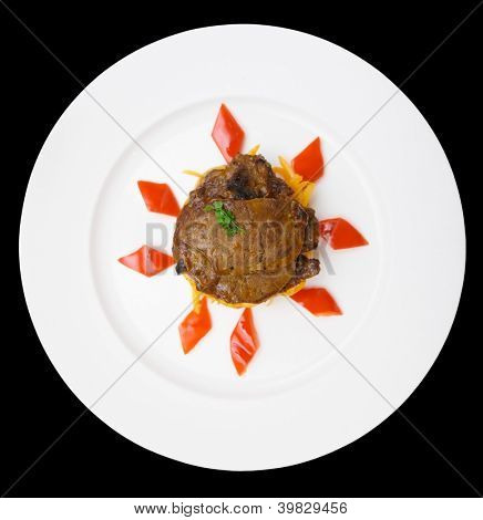 Fried venison in porcelain plate, isolated on black