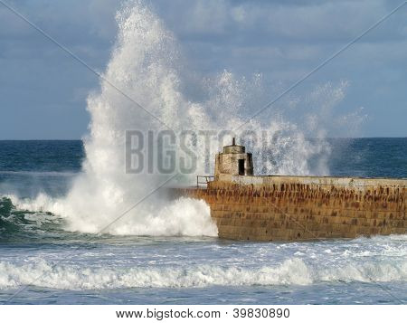 Portreath pier big white water wave splash, Cornwall UK.