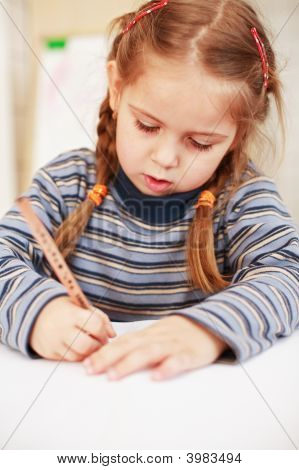 Cute Little Girl Painting At Home