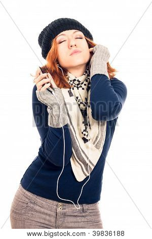 Young Woman In Winter Clothes Listening Music