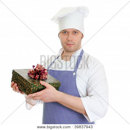 Young Chef Cook Holding Present Box. Isolated On White