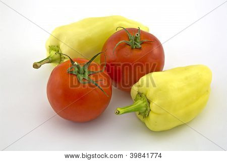 Two Sweet Peppers And Tomatoes