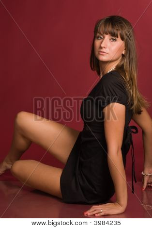 Young Girl Sitting Half-Turned