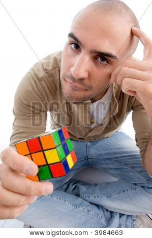Confused Man Holding Puzzle Cube