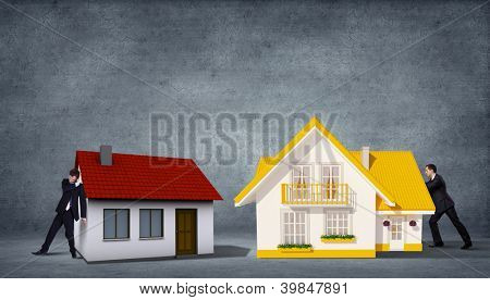 Business person with piece of puzzle ( jigsaw ) building a house