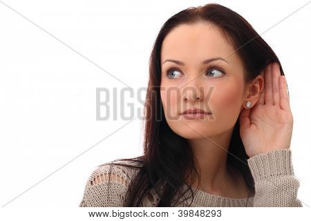 Beautiful and attractive girl listening gesture over a white background