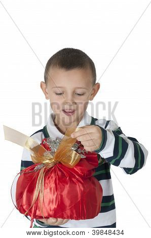 happy little boy opening the gift