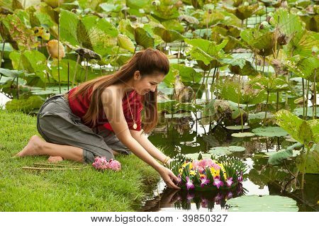 Pretty Woman In Thai Style Clothes Floating Flower Joist.