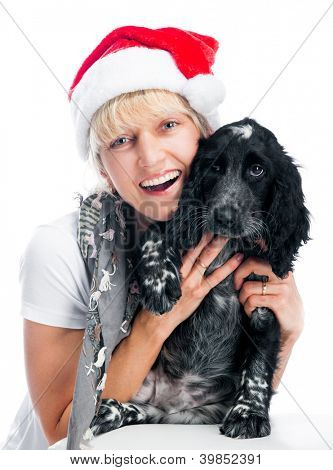 pretty young woman and dog in santa hat at Christmas
