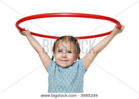 The Girl Holds A Gymnastic Hoop
