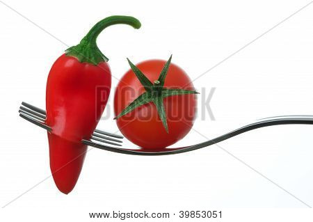 Chili Pepper And Tomato On A Fork