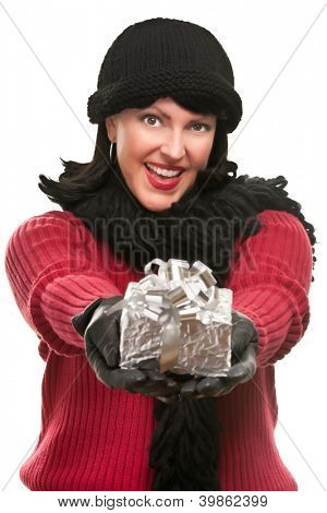 Pretty Young Woman Offering Holiday Gift Isolated on a White Background.