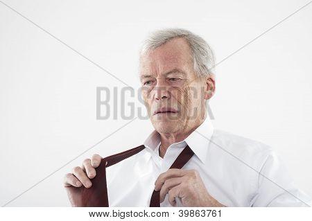 Elderly Man Putting On His Tie