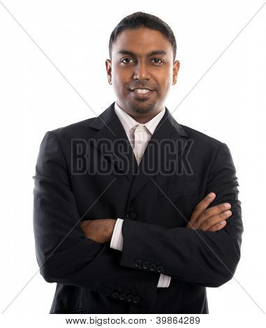 Good looking 30s Indian male crossed arms over white background