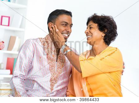 Happy mature Indian woman with her adult son