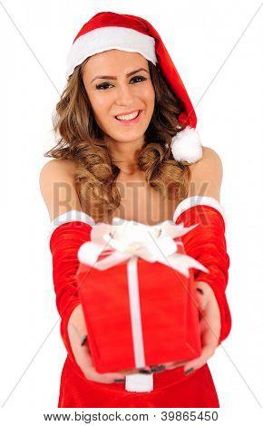 Isolated young christmas woman giving gift