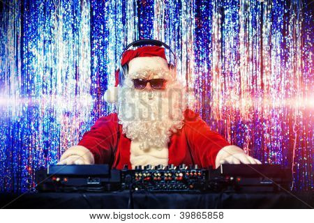 DJ Santa Claus mixing up some Christmas cheer. Disco lights in the background.