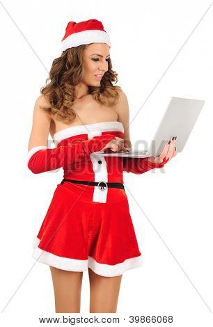 Isolated young christmas woman using laptop