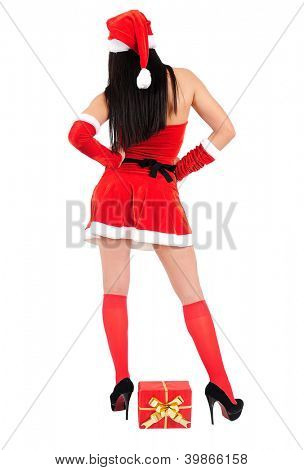 Isolated young christmas girl with gift box