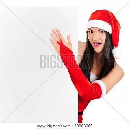 Isolated young brunette christmas girl amazed