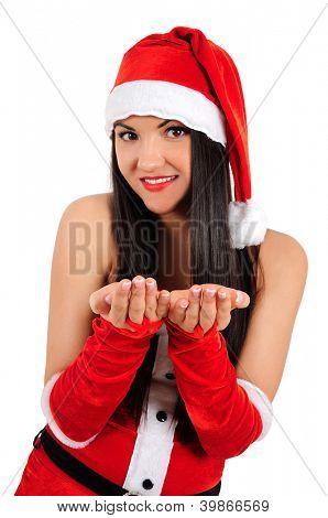Isolated young brunette christmas girl giving something