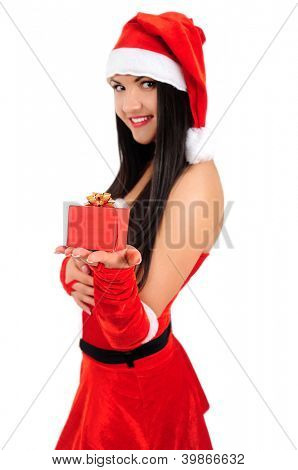 Isolated young brunette christmas girl giving gift