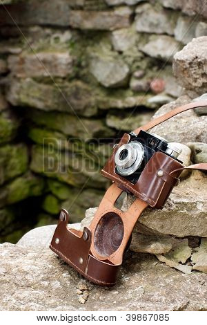 Old Camera On Rocks